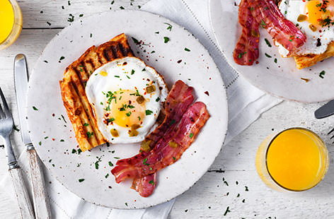 Jalapeño and cheese waffles with bacon and eggs