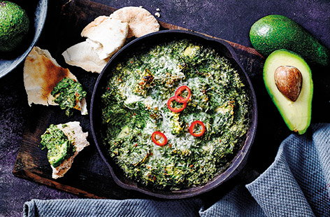 Make this easy vegetarian dip with avocados and spinach for a movie-night snack. Serve with toasted pitta breads for scooping and dipping