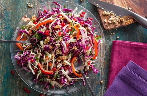 This super-healthy winter salad is bursting with flavour and goodness. There's Vitamin C from the red and white cabbage, red onion and red pepper, while the pomegranate seeds add bite (and a touch of sparkle!). Walnuts add an earthy crunch.