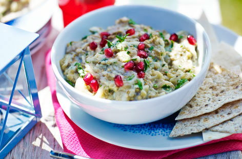 This take on a Middle Eastern baba ganoush is the ideal dip to accompany any picnic you've been planning. Charring the aubergines till they're just on the right side of burnt is what gives the dip its unqiue smoky flavour. Scatter with pomegranate seeds and serve.