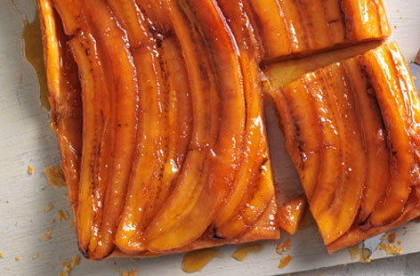 Caramelised bananas and a healthy glug of rum are the secret ingredients in this banana tarte tatin. A 30-minute stint in the oven, until the pastry is puffed and golden, and the caramel sauce is bubbling at the edges, is all it takes to make the tart come to life. Serve with vanilla ice cream.