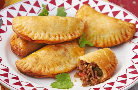 Like cute little pasties, these Spanish empanadas are perfect party finger fodder, filled with a spicy mince sauce with onions and peppers. Serve with a bowl of sour cream or any of your favourite condiments for dipping and dunking.