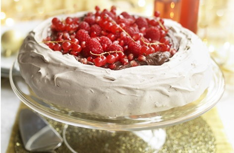 A wonderful indulgent celebratory dessert, this chocolate, raspberry and pomegranate pavlova is perfect for entertaining guests and it can even be prepared in advance and assembled just before serving