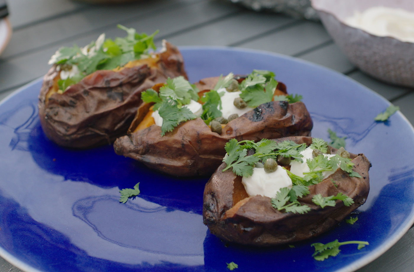 Ember-roasted sweet potatoes with cream cheese and capers recipe