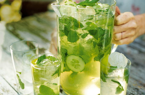 Packed full of lime, mint and basil, this thirst quenching green sangria is the perfect drink for summer entertaining