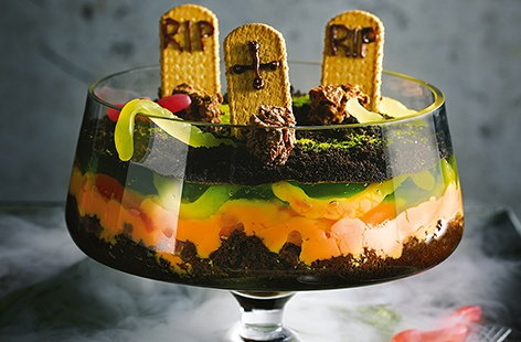 With rich chocolate brownies, vibrant orange custard and creepy green jelly, this spooky twist on a classic trifle is a scarily good Halloween party idea that will definitely impress the kids