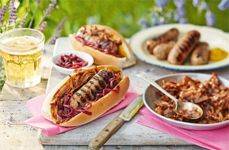 Hot dogs with pulled pork and a red onion relish