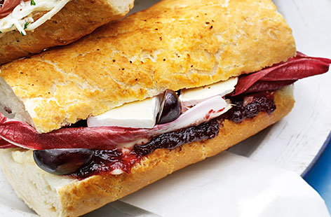 Need some picnic or lunch inspiration? This delicious vegetarian sandwich should do the trick! The sweetness of the grape and cranberry work perfectly with the mild, lightly creamy cheese. As for the bread? It has to be a baguette.