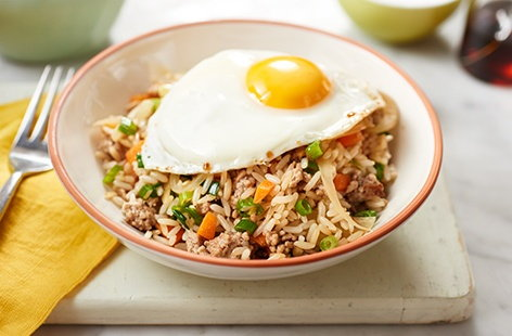 This much-loved Chinese dish makes a great midweek meal – marinated pork with stir-fried vegetables and rice, topped off with a fried egg
