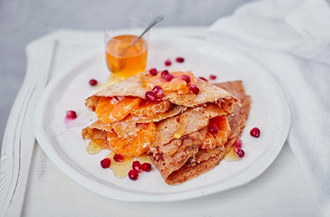 Spelt pancakes with clementine and pomegranate